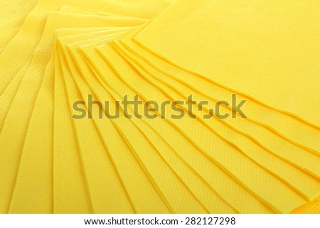 Yellow Serving colored paper napkins closeup - stock photo