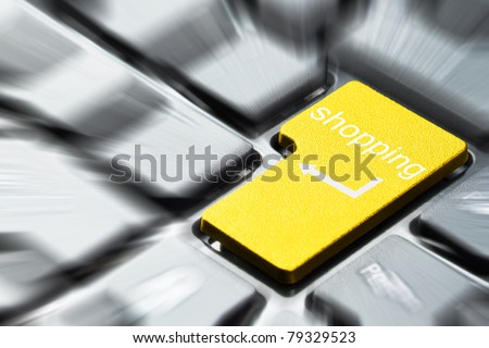 Yellow shopping button on the keyboard - stock photo