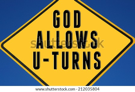 Yellow sign God allows U-Turns  - stock photo