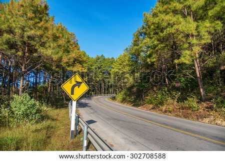 yellow sign on the road with clear sky at the way to pai , chiang mai , Thailand. - stock photo