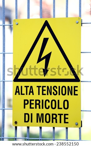 yellow sign with potentially fatal HIGH VOLTAGE in an industrial plant - stock photo
