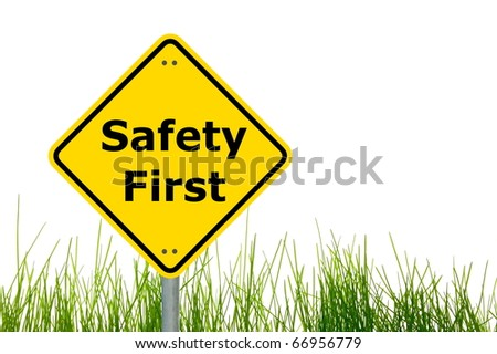 yellow sign with safety first as aid concept - stock photo