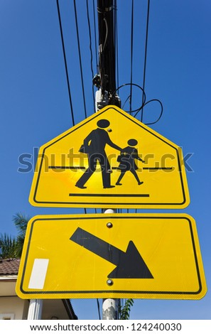 yellow signpost beware the children - stock photo