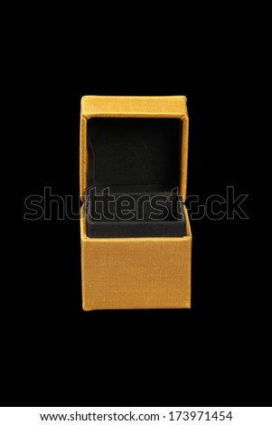 Yellow silk box on dark background - stock photo