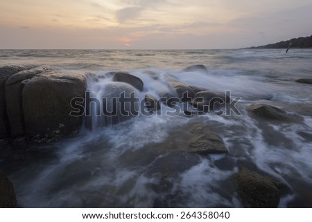 yellow sky with the beach - stock photo