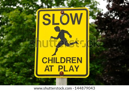 Yellow Slow Children at Play Road Sign