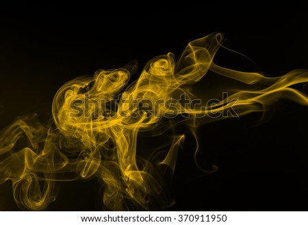 Yellow smoke abstract dark background - stock photo