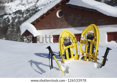 Yellow snowshoes in Canfranc Valley, Pyrenees, Huesca, Aragon, Spain - stock photo