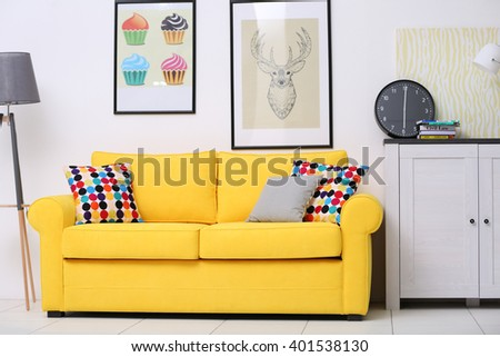 Yellow sofa in the living room - stock photo