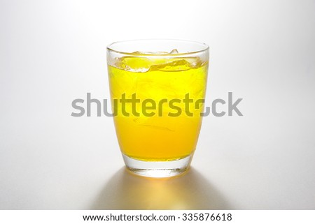 yellow soft drink on white background