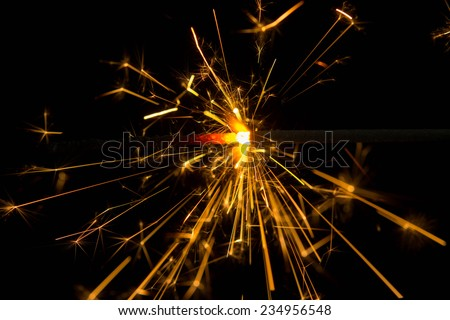 yellow sparkler holiday background  - stock photo