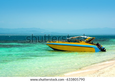 yellow speed boat  Parking on the sea beach with blue sky