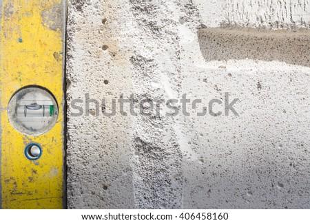 Yellow spirit on white concrete block - stock photo