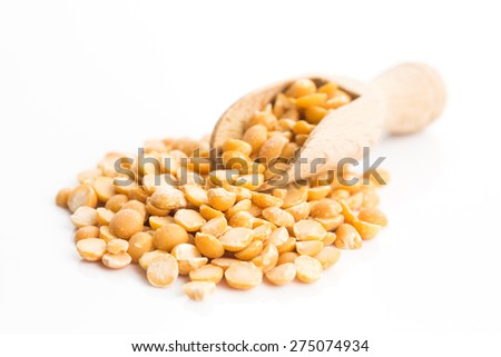Yellow split peas isolated on white background - stock photo