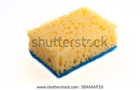 Yellow sponge for washing utensils - stock photo