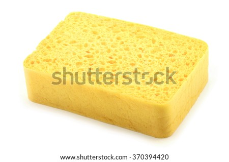 Yellow sponge isolated on a white background. - stock photo