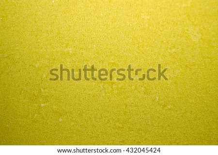 Yellow sponge  with green scrubber - isolated - stock photo