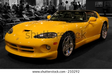 Yellow sports car on a desaturated background