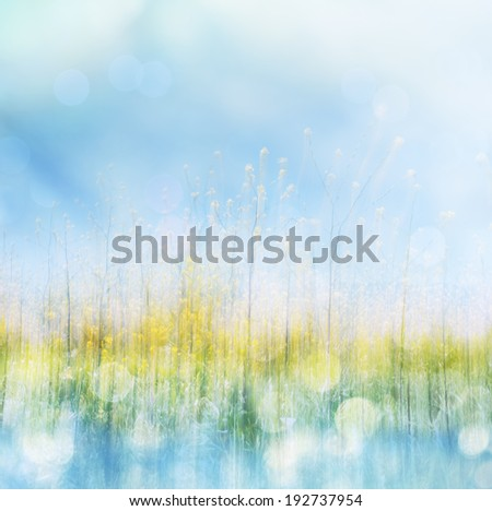 Yellow spring flowers with bokeh light effects.  Image made with panning motion for a soft blurring of textures. - stock photo