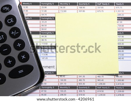 Yellow Square Blank Post-It Note And Calculator On A Business Background - Space For Own Text