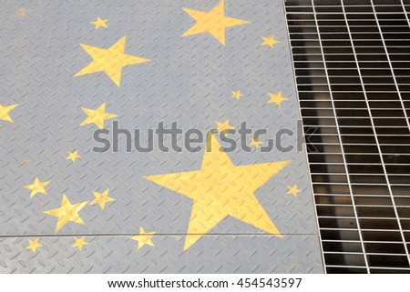 Yellow stars in the checkered plate, closeup of photo