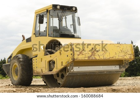 yellow steamroller