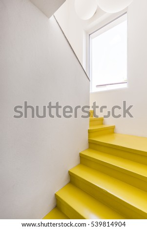 Yellow steps of the staircase in minimalist bright house