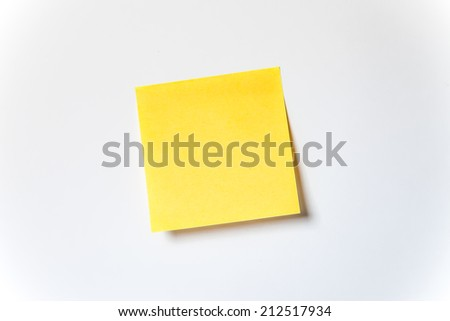 Yellow stick note paper on white background, blank yellow adhesive note on white background with shadow - stock photo