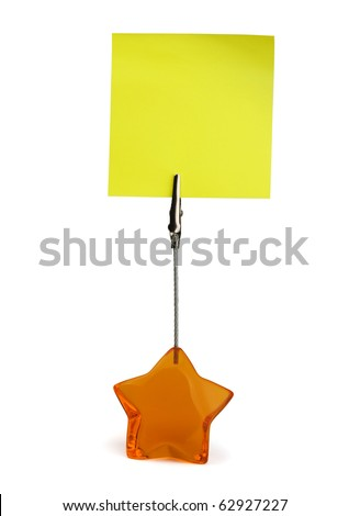 Yellow sticky note in paper holder isolated on white - stock photo