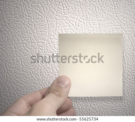 yellow sticky note on a fridge