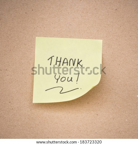 yellow sticky note thank you on brown paper texture close up - stock photo