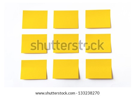 Yellow sticky notes on white background - stock photo