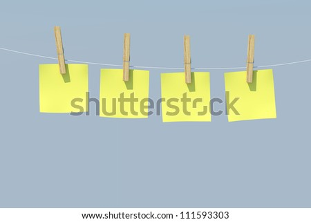 Yellow Sticky Notes with wood Clothespin - Isolated on Background