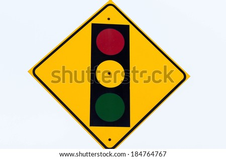 yellow stop light sign with yellow orange and green lights