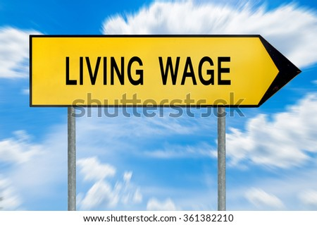 Yellow street concept living wage sign - stock photo