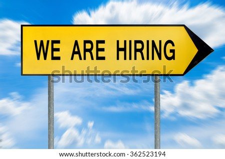 Yellow street concept we are hiring sign - stock photo