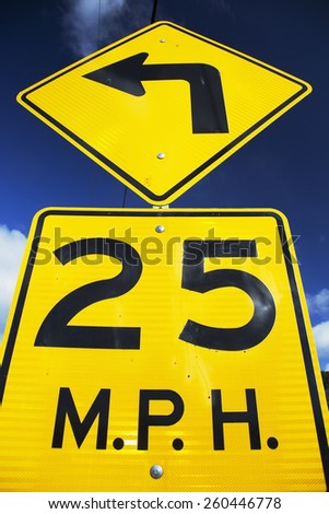 Yellow street sign saying 25 Miles Per House, 04.26.2014 - stock photo