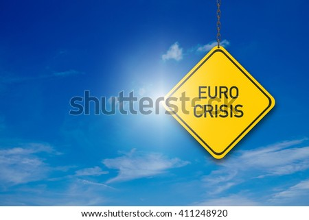 Yellow Street Sign with Euro Crisis on blue Background - stock photo