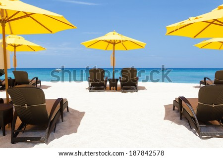 Yellow sun umbrellas and beach chairs,boracay,Philippines - stock photo
