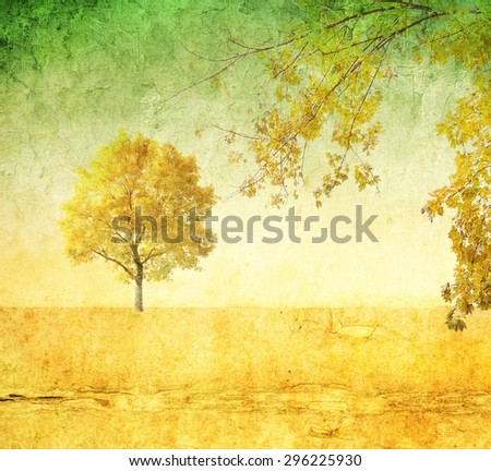 Yellow surreal landscape with single tree - stock photo