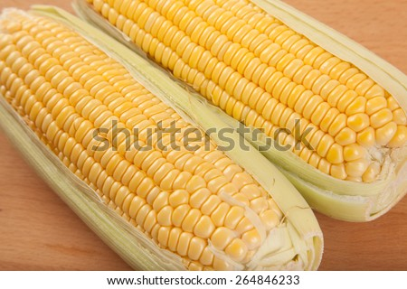 Yellow sweetcorn on wooden table