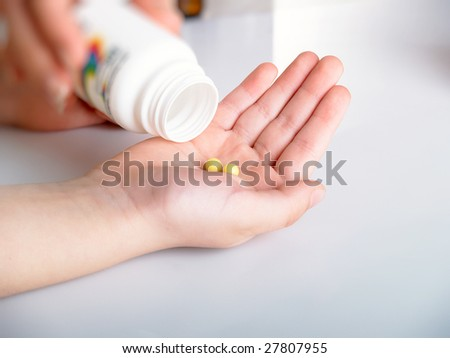 Yellow tablets in a children's hand