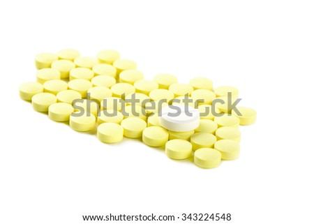 Yellow tablets isolated on white background - stock photo