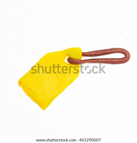 Yellow tag on a string, plasticine miniature. The price tag of plasticine.