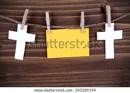 Yellow Tag Or Label With Two Crosses On A Line With Copy Space Or Your Free Text Here On Wooden Background, Two Symbols, Vintage, Retro and Old Fashion Style With Frame - stock photo