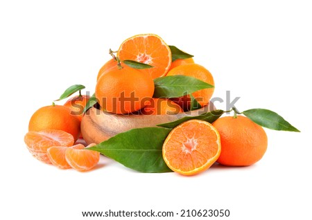 Yellow tangerines in wooden plate on white background