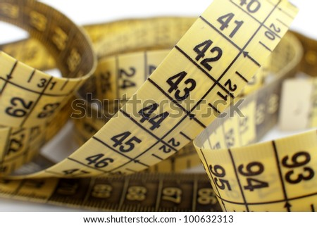yellow tape measure on the white background