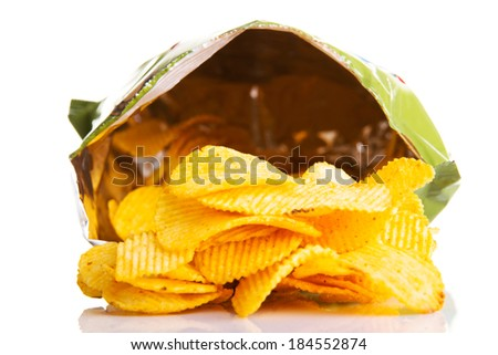 Yellow, tasty but unhealthy potatoe chips. Isolated on white. - stock photo