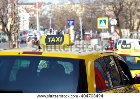 yellow taxi cabs waiting for a passenger