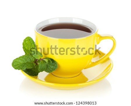 Yellow tea cup with mint. Isolated on white background